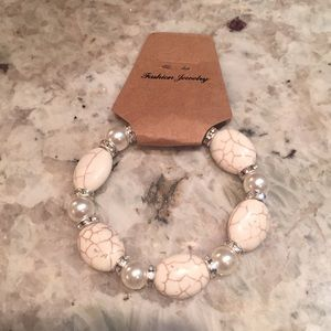Off White Bracelet With Pearl Colored Beads